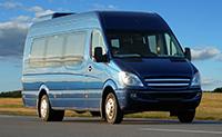 Blue minibus on highway
